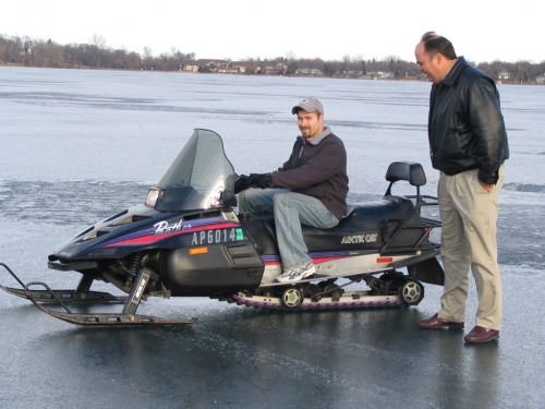 Tim on a snowmobile