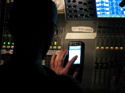 Sound guy playing on iPhone